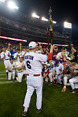 Republican coach Joe Barton holds up the trophy after the Roll Call Congressional Baseball Game at National Stadium on Thursday July 17 2008