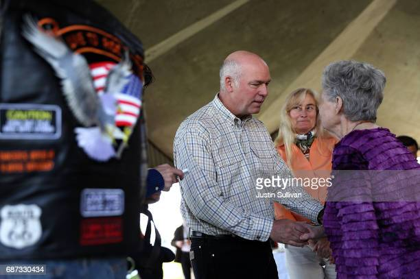 Republican congressional candidate Greg Gianforte greets supporters during a campaign meet and greet at Lions Park on May 23 2017 in Great Falls...