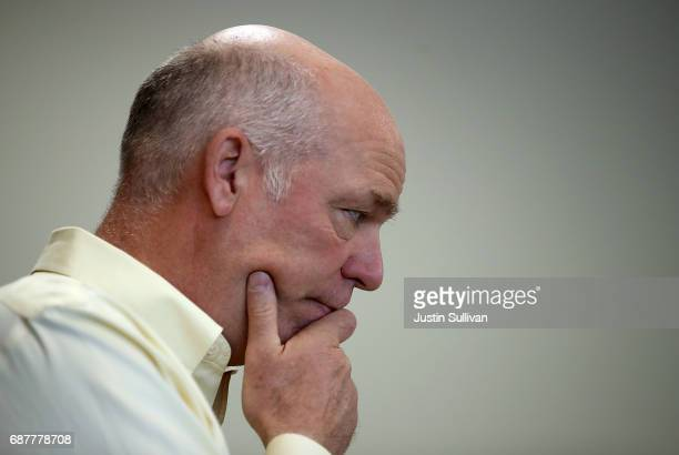 Republican congressional candidate Greg Gianforte looks on during a campaign meet and greet at Lambros Real Estate on May 24 2017 in Missoula Montana...