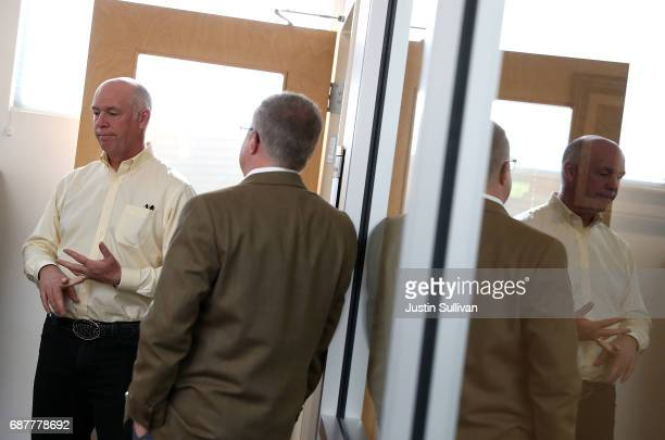 Republican congressional candidate Greg Gianforte talks with a supporter during a campaign meet and greet at Lambros Real Estate on May 24 2017 in...