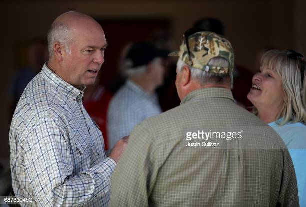 Republican congressional candidate Greg Gianforte talks with supporters during a campaign meet and greet at Lions Park on May 23 2017 in Great Falls...