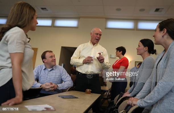 Republican congressional candidate Greg Gianforte talks with supporters during a campaign meet and greet at Lambros Real Estate on May 24 2017 in...
