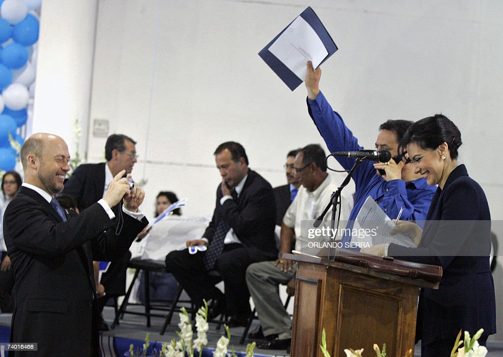 Republican congressman Jerry Weller takes pictures of his wife Zury Rios during the presentation of his father in law Guatemalan ex dictator Efrain...