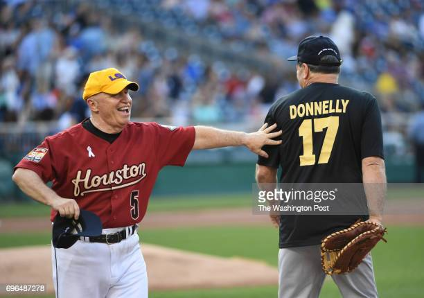 Republican Congressman Robert Brady jokes with Democratic first baseman Donnelly during the Congressional baseball game on June 15 2017 in Washington...
