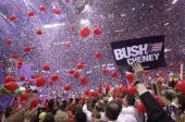Republican delegate holds up a sign supporting George W Bush and Dick Cheney as balloons fall during the Republican National Convention August 3 2000...