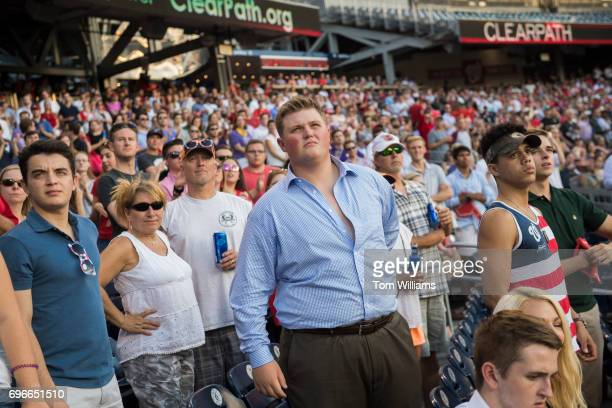 Republican fans watch a message from President Trump during the 56th Congressional Baseball Game at Nationals Park on June 15 2017