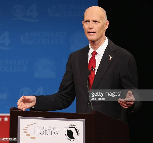 Republican Florida Governor Rick Scott speaks during a televised debate with former Florida Governor and Democratic candidate Charlie Crist at...