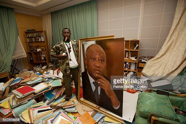 Republican Forces loyal to elected President Alassane Ouattara loot the residence of Laurent Gbagbo arrested earlier on April 11 A soldier loyal to...