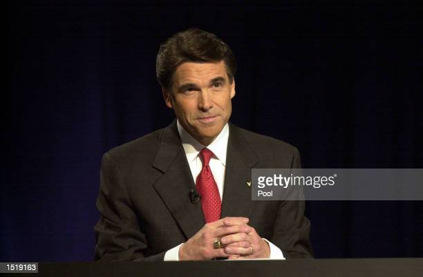 Republican Governor Rick Perry prepares for a debate in the studios of KERA October 24 2002 in Dallas Texas Perry is being challenged by Democrat...