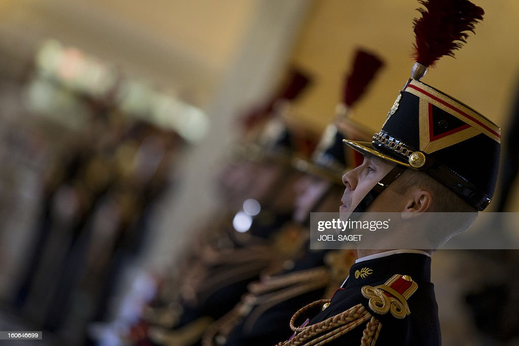 Republican guards are in faction on February 4, 2013 at the National Assembly in Paris.