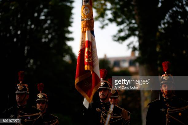 Republican Guards are pictured during the official handover ceremony of the French defence minister at the Hotel de Brienne in Paris on June 21 2017...