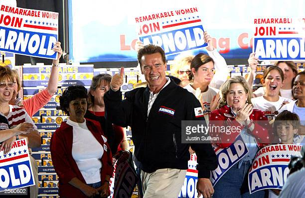 Republican gubernatorial candidate Arnold Schwarzenegger gives the thumbsup during a rally at PR Farms October 4 2003 in Clovis California...
