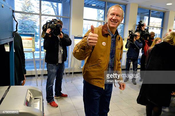 Republican Gubernatorial Candidate Bruce Rauner gives the thumbsup after casting his ballot in the Illinois primary election on March 18 2014 in...