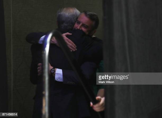 Republican gubernatorial candidate Ed Gillespie embraces a supporter backstage before speaking at an election night rally on November 7 2017 in...