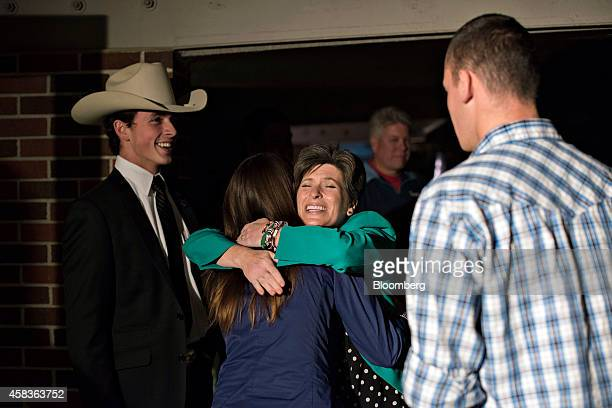 Republican Joni Ernst running for the US Senate in Iowa center right greets attendees during a campaign stop at the Alpha Gamma Rho fraternity on the...