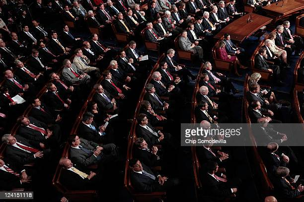 Republican members of Congress listen as US President Barack Obama addresses a Joint Session of Congress at the US Capitol September 8 2011 in...