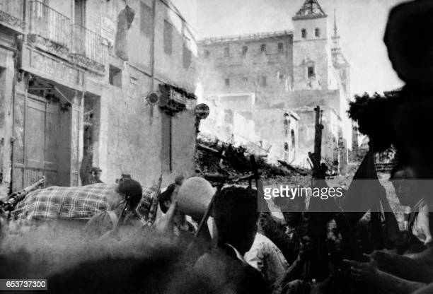 Republican militiamen besieged in the summer of 1936 the Alcazar fortress in Toledo the military academy to which some 1800 nationalist fighters had...