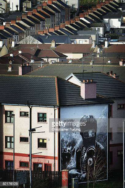 Republican mural is seen on the side of a house in the Bogside are of Londonderry the scene of the 'Bloody Sunday' shootings on February 10 2005 in...
