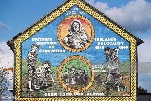 Republican mural on Upper Falls Road in Belfast argues that Britain was responsible for genocide during the potato famine of 18451849 This is one of...