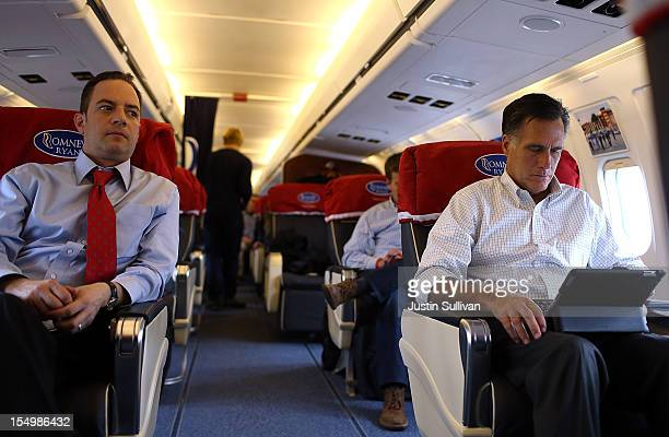 Republican National Committee chairman Reince Priebus looks on as Republican presidential candidate former Massachusetts Gov Mitt Romney works on his...