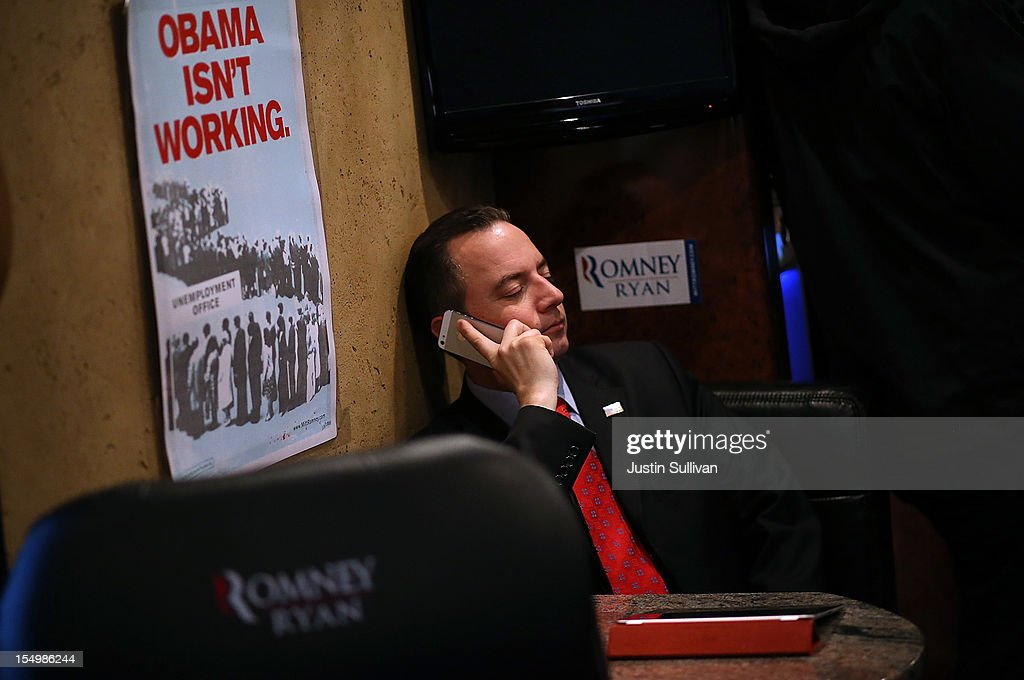 Republican National Committee chairman <a gi-track='captionPersonalityLinkClicked' href=/galleries/search?phrase=Reince+Priebus&family=editorial&specificpeople=7419119 ng-click='$event.stopPropagation()'>Reince Priebus</a> talks on the phone while riding on the campaign bus of Republican presidential candidate, former Massachusetts Gov. Mitt Romney en route to a campaign rally at Avon Lake High School on October 29, 2012 in Avon Lake, Ohio. Romney canceled campaign events on October 29 and 30 due to Hurricane Sandy.