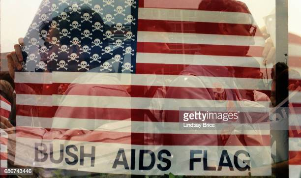 1992 Republican National Convention Protests View of 'Bush AIDS Flag' interpretation of the American flag stars replaced with skulls and crossbones...