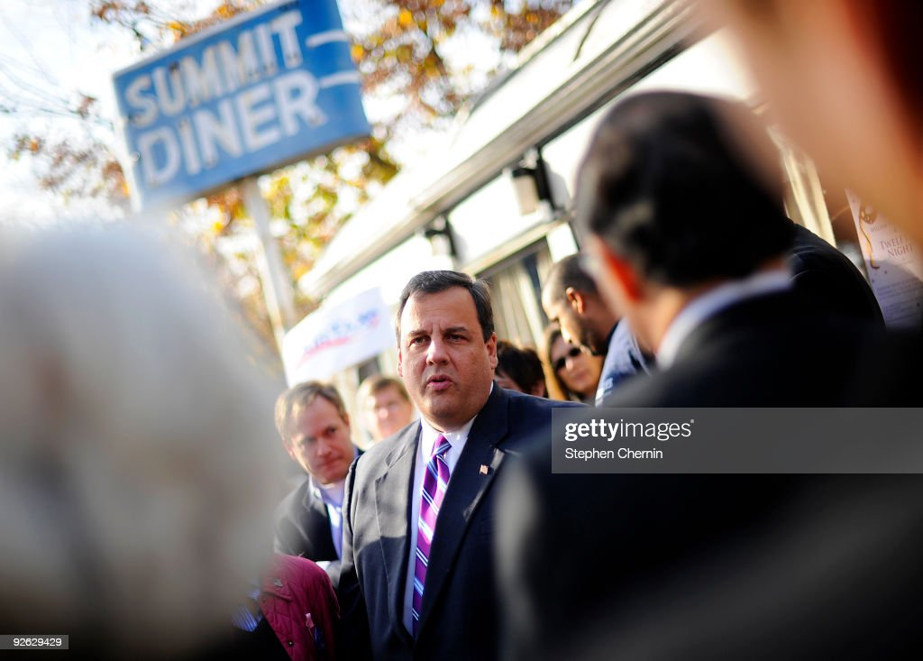 Republican New Jersey Gubernatorial hopeful Chris Christie (C) speaks with supporters outside the Summit Diner after making a campaign stop November 3, 2009 in Summit, New Jersey. Christie is challenging incumbent Democrat NJ Gov. John Corzine.