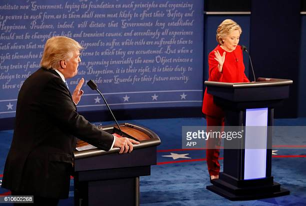 Republican nominee Donald Trump and Democratic nominee Hillary Clinton exchange during the first presidential debate at Hofstra University in...