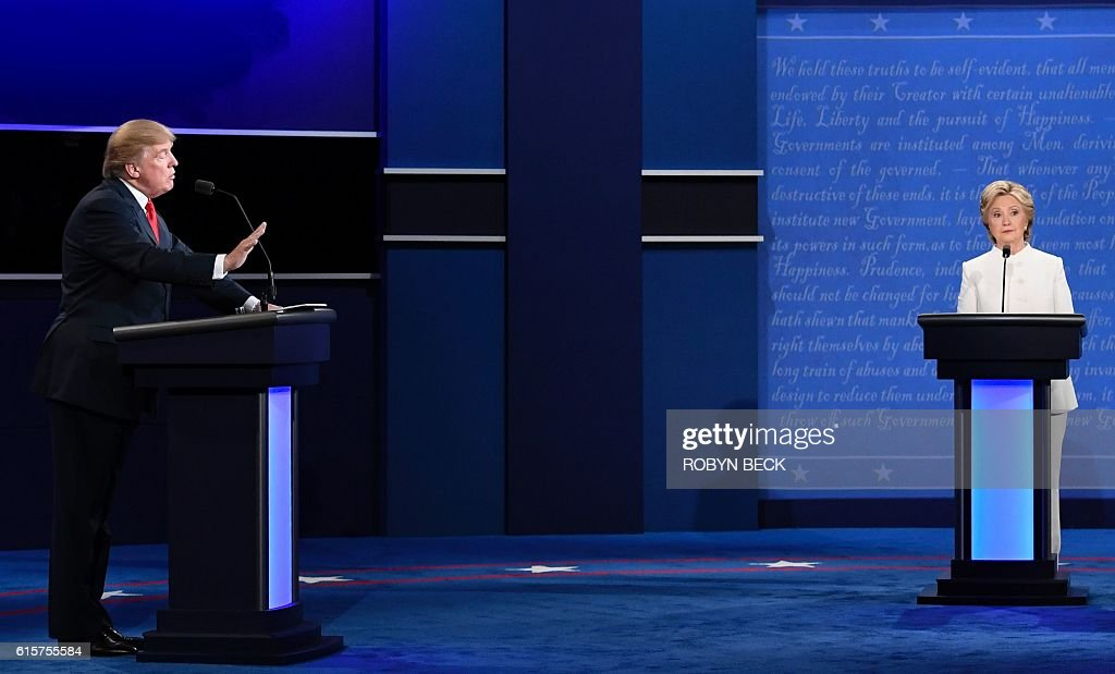 TOPSHOT - Republican nominee Donald Trump (L) gestures as Democratic nominee Hillary Clinton looks on during the final presidential debate at the Thomas & Mack Center on the campus of the University of Las Vegas in Las Vegas, Nevada on October 19, 2016. / AFP / Robyn BECK