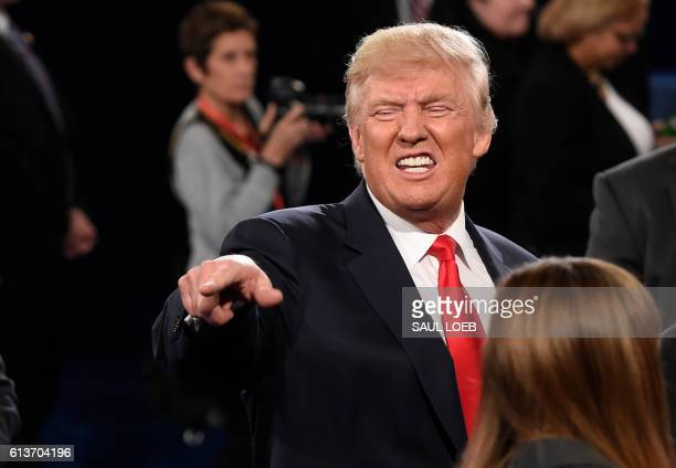 TOPSHOT Republican nominee Donald Trump poses with members of the audience after the second presidential debate at Washington University in St Louis...