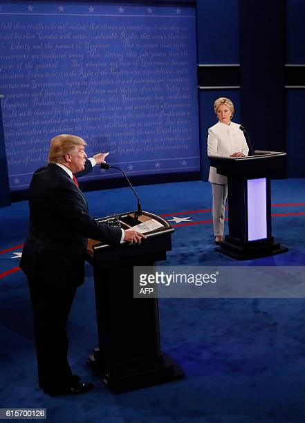 Republican nominee Donald Trump speaks as Democratic nominee Hillary Clinton looks on during the final presidential debate at the Thomas Mack Center...