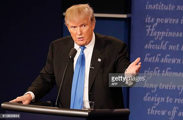 Republican nominee Donald Trump talks during the first presidential debate at Hofstra University in Hempstead New York on September 26 2016 Hillary...