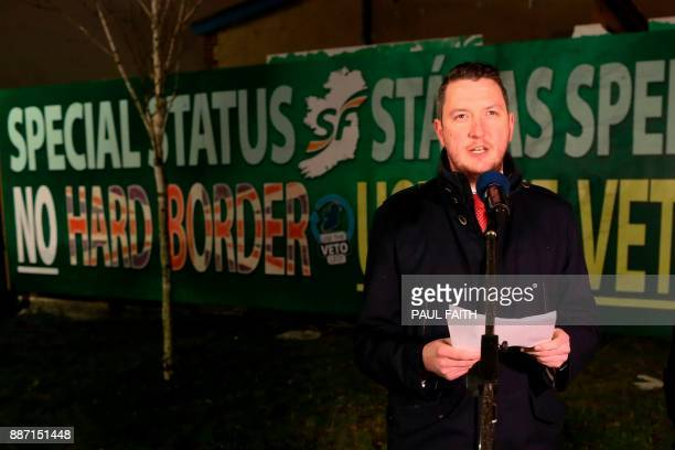 Republican Party Sinn Fein's John Finucane speaks in front of a new antiBrexit mural erected by Sinn Fein in west Belfast on December 6 2017 to call...