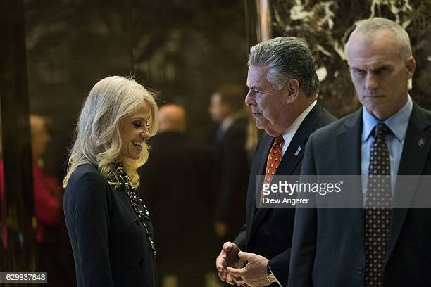 Republican political strategist Kellyanne Conway talks with US Rep Peter King in the lobby at Trump Tower December 15 2016 in New York City...