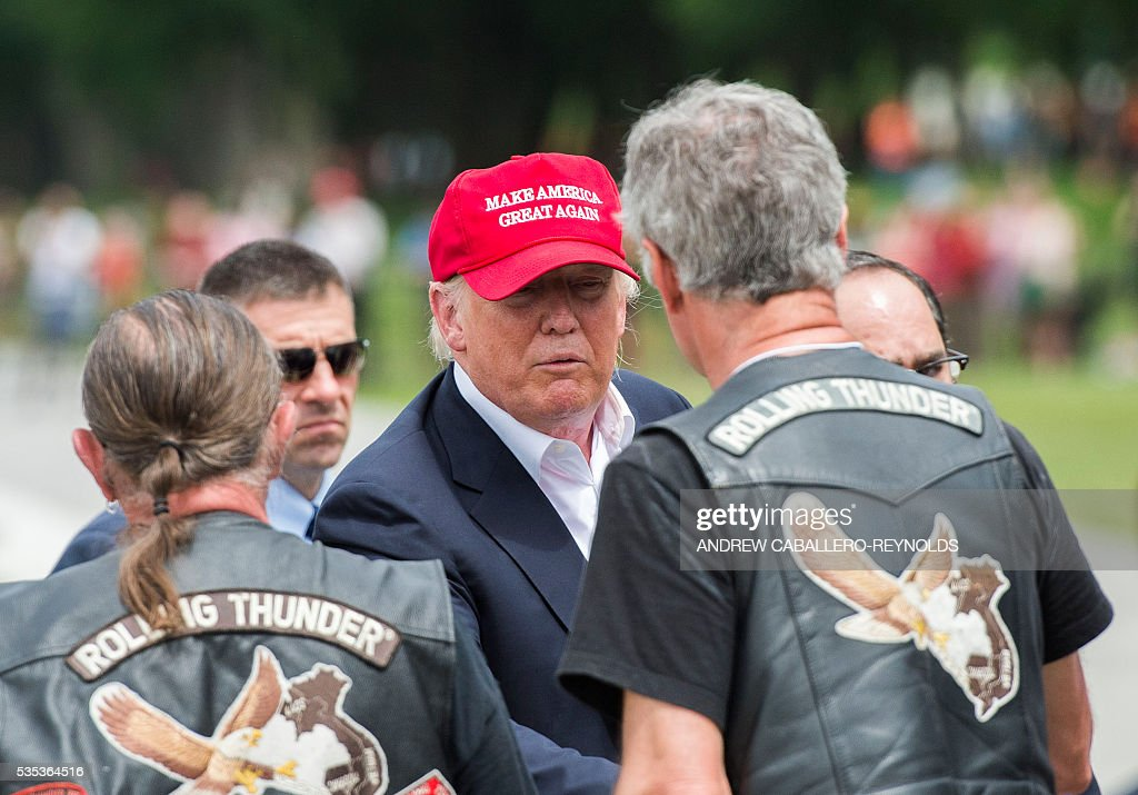 Republican presedential candidite Donald Trump shakes hands with veterans during the annual Rolling Thunder 'Ride for Freedom' parade ahead of Memorial Day in Washington, DC, on May 29, 2016. / AFP / Andrew Caballero-Reynolds