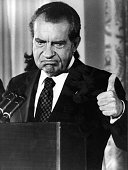 Republican president of the United States Richard Nixon thumbing up after announcing his resignation from the presidency after the Watergate scandal...