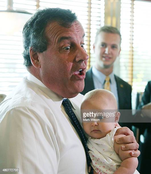 Republican presidentail candidate New Jersey Gov Chris Christie holds fourmonthold Arlea Giovanna during a campaign stop with Maryland Gov Larry...