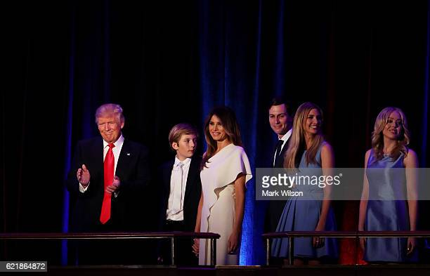 Republican presidentelect Donald Trump acknowledges the crowd along with his son Barron Trump wife Melania Trump Jared Kushner Ivanka Trump and...