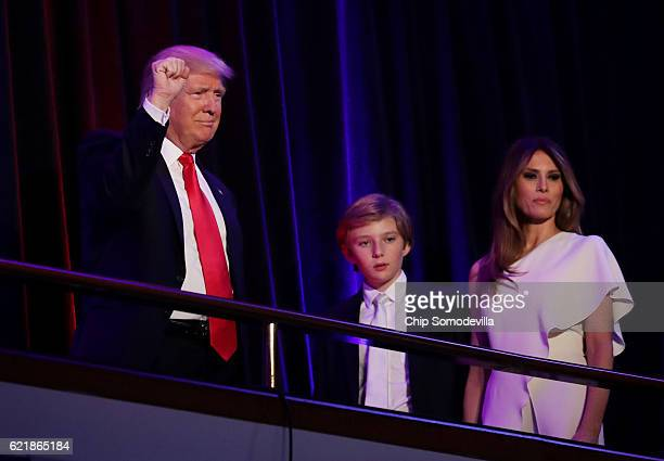 Republican presidentelect Donald Trump acknowledges the crowd along with his son Barron Trump and his wife Melania Trump during his election night...