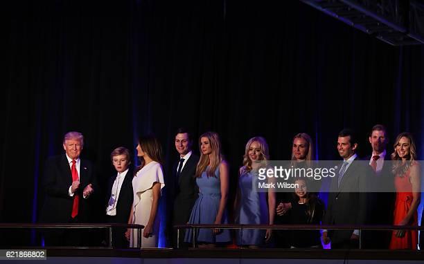 Republican presidentelect Donald Trump acknowledges the crowd along with his son Barron Trump wife Melania Trump Jared Kushner Ivanka Trump Tiffany...