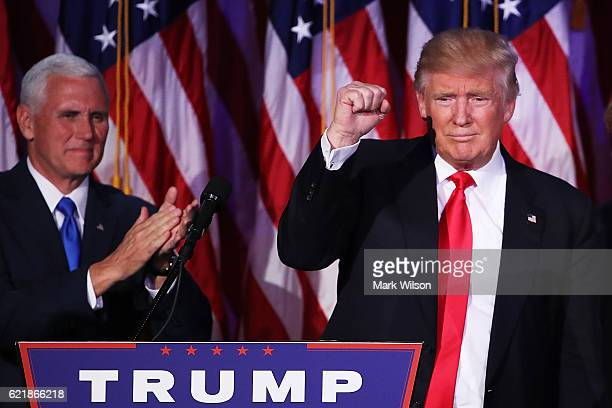 Republican presidentelect Donald Trump acknowledges the crowd as Vice presidentelect Mike Pence looks on during his election night event at the New...