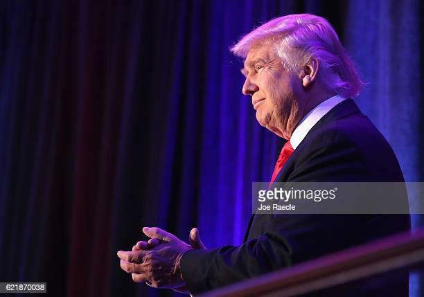 Republican presidentelect Donald Trump acknowledges the crowd during his election night event at the New York Hilton Midtown in the early morning...