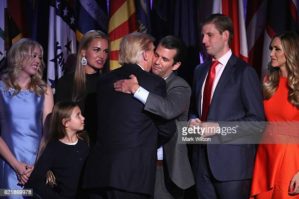Republican presidentelect Donald Trump and his son Donald Trump Jr embrace after delivering his acceptance speech at the New York Hilton Midtown in...