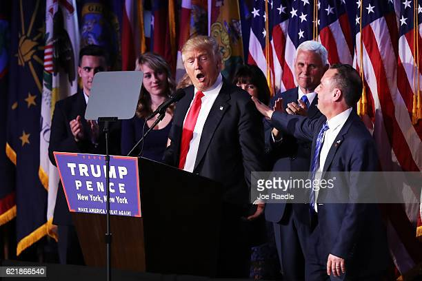 Republican presidentelect Donald Trump delivers his acceptance speech as Vice presidentelect Mike Pence and Reince Priebus chairman of the Republican...