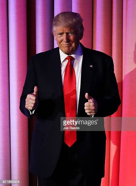 Republican presidentelect Donald Trump gives two thumbs up to the crowd during his election night event at the New York Hilton Midtown in the early...