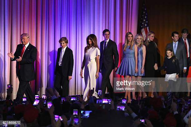Republican presidentelect Donald Trump walks on stage along with his son Barron Trump wife Melania Trump Jared Kushner Ivanka Trump Tiffany Trump...