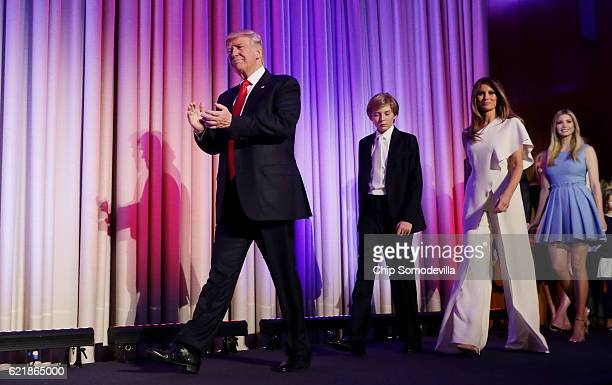 Republican presidentelect Donald Trump walks on stage with his son Barron Trump wife Melania Trump and Ivanka Trump during his election night event...