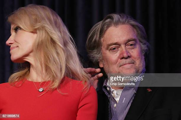 Republican presidentelect Donald Trump's campaign manager Kellyanne Conway and Trump campaign CEO Stephen Bannon stand on stage during the election...