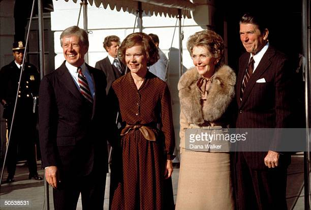 Republican Presidentelect Ronald Reagan and wife Nancy standing with President Jimmy Carter wife Roslyn outside the White House