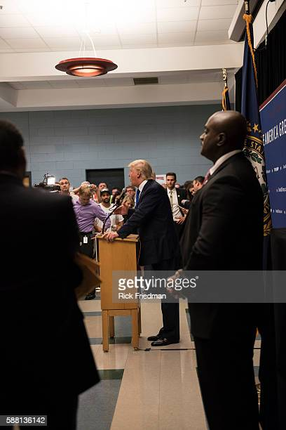 Republican presidential businessman Donald Trump talking to the crowd in the overflow room at a campaign rally at Pinkerton Academy in Derry New...